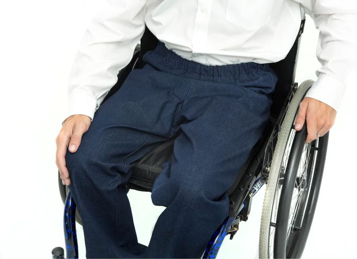 Elasticated waist wheelchair jeans sat in wheelchair